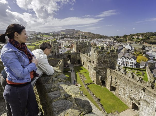 Couple visiting the castle Conwy Castle