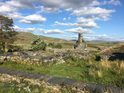 Rustic and Wild Welsh landscape of a ruined farmhouse